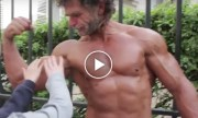 50-year-old homeless bodybuilder, trains on the streets of Paris without weights.