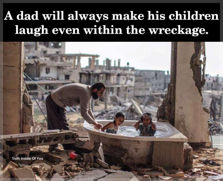 A dad will always make his children laugh even within the wreckage.