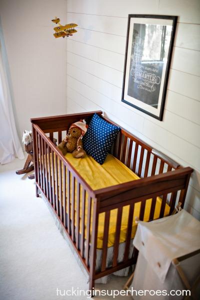 nursery crib tucking in superheroes.com.jpg
