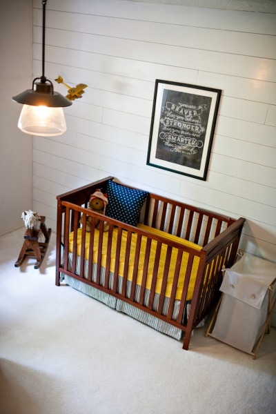 nursery planked wall tucking in superheroes.com.jpg