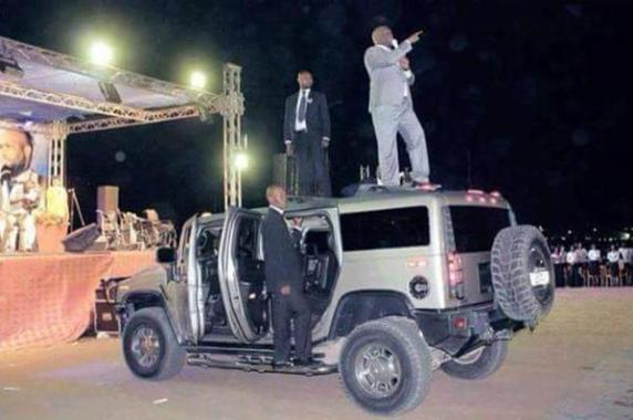 pastor preaching on hummer