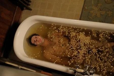 aidan in bathtub of garlic 1