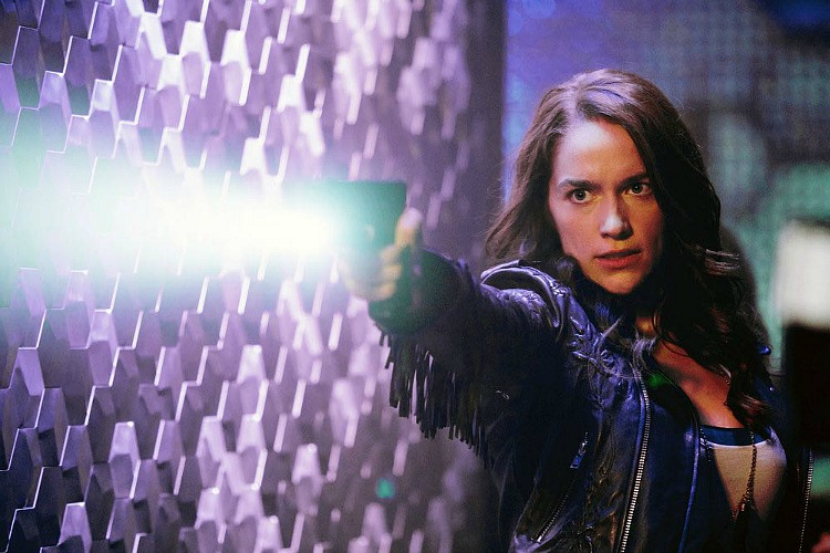 "WYNONNA EARP -- ""Keep the Home Fires Burning"" Episode 102 -- Pictured: Melanie Scrofano as Wynonna Earp -- (Photo by: Michelle Faye/Syfy/Wynonna Earp Productions)"