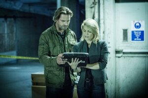 "COLONY -- ""Getaway"" Episode 110 -- Pictured: (l-r) Josh Holloway as Will Bowman, Kathleen Rose Perkins as Jennifer McMahon -- (Photo by: Isabella Vosmikova/USA Network)"