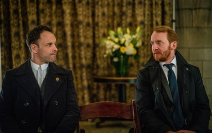 """The Invisible Hand"" -- When Holmes and Watson discover the perpetrator behind the attempt made on Morland's (John Noble) life, they find a shocking connection to themselves, on ELEMENTARY, Sunday, May 1 (10:00-11:00 PM, ET/PT) on the CBS Television Network.  Pictured  (L-R) Jonny Lee Miller as Sherlock Holmes and Tony Curran  as Joshua Vikner  Photo:  Michael Parmelee/CBS ©2015 CBS Broadcasting, Inc. All Rights Reserved"