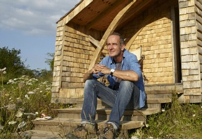 Kevin McCloud relaxes outside his shed