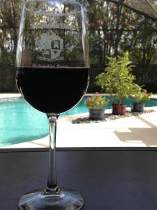 Wine glass by pool