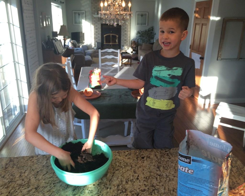 kids work together on Easter Garden