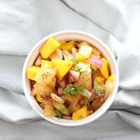 Chili Pineapple Mango Salsa! Super quick and easy to make. Healthy and a great switch from regular salsa! Vegan and Gluten Free! / TwoRaspberries.com
