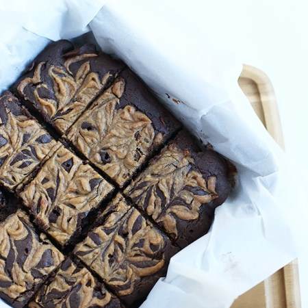 These Vegan Gluten Free Caramel Brownies are super dense and moist. Refined sugar free, naturally sweetened with maple syrup and applesauce! / TwoRaspberries.com