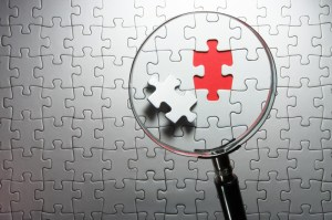 photo of a magnifying glass looking at a puzzle