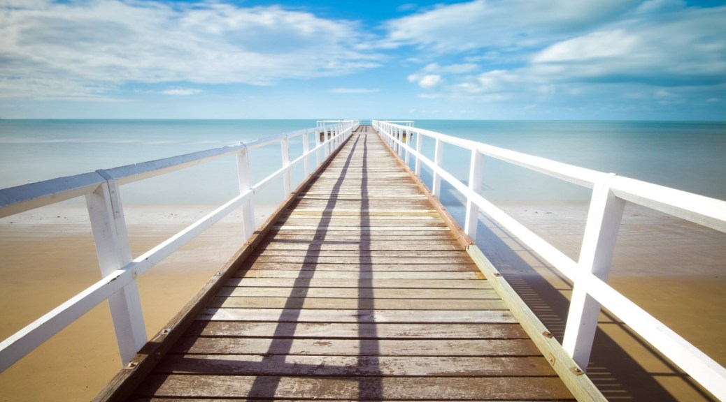pier-in-diminishing-perspective-on-sunny-day