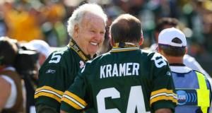 Oct 2, 2011; Green Bay, WI, USA; Former Green Bay Packers Paul Hornung (5) and Jerry Kramer (64) talk prior to the game against the Denver Broncos at Lambeau Field. The Packers defeated the Broncos 49-23. Mandatory Credit: Brace Hemmelgarn-USA TODAY Sports