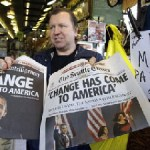 Newspaper vendor Chad Smith displays copies of the Seattle Post-Intelligencer, left, and The Seattle Times, featuring the election of Barack Obama as president, that he had set aside for himself before the editions sold out at the Read All About It newsstand in Seattle's Pike Place Market Wednesday. (Elaine Thompson / Associated Press )