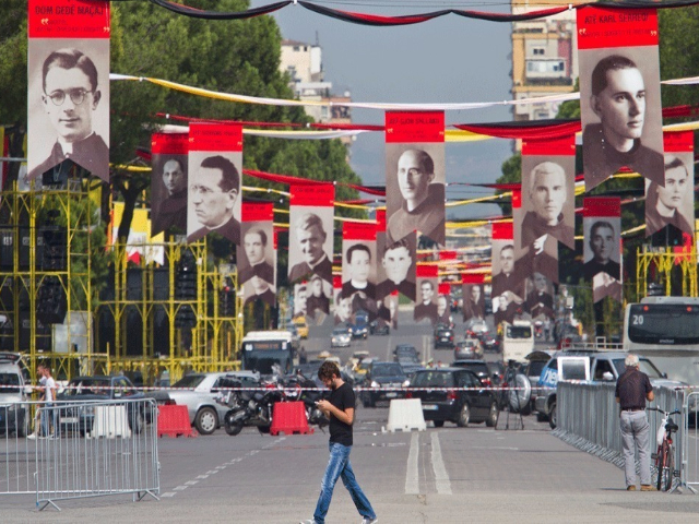 Pictures of Albanian Catholic Martyrs hung in the Tirana main boulevard in September 2014. Photo: AP/Visar Kryeziu