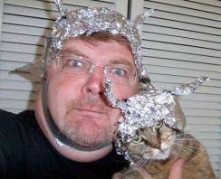 man and cat wearing foil hats