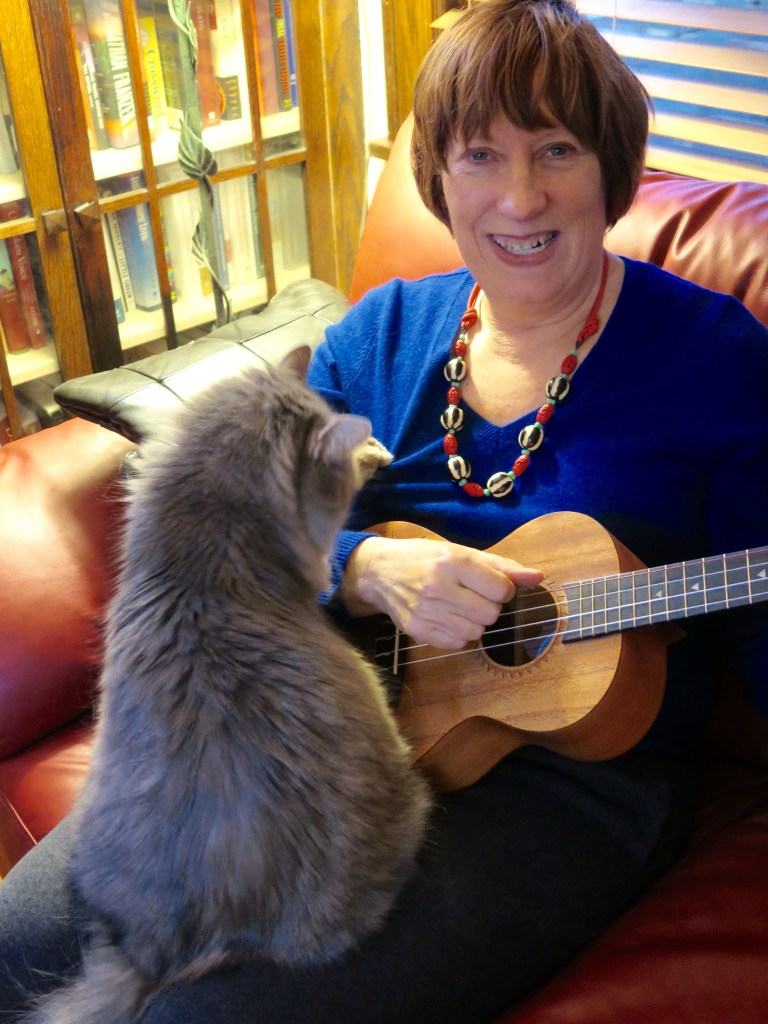 Lisa Lorimer.Oscar demands attention as she attempts to practice with a Luna tenor uke.