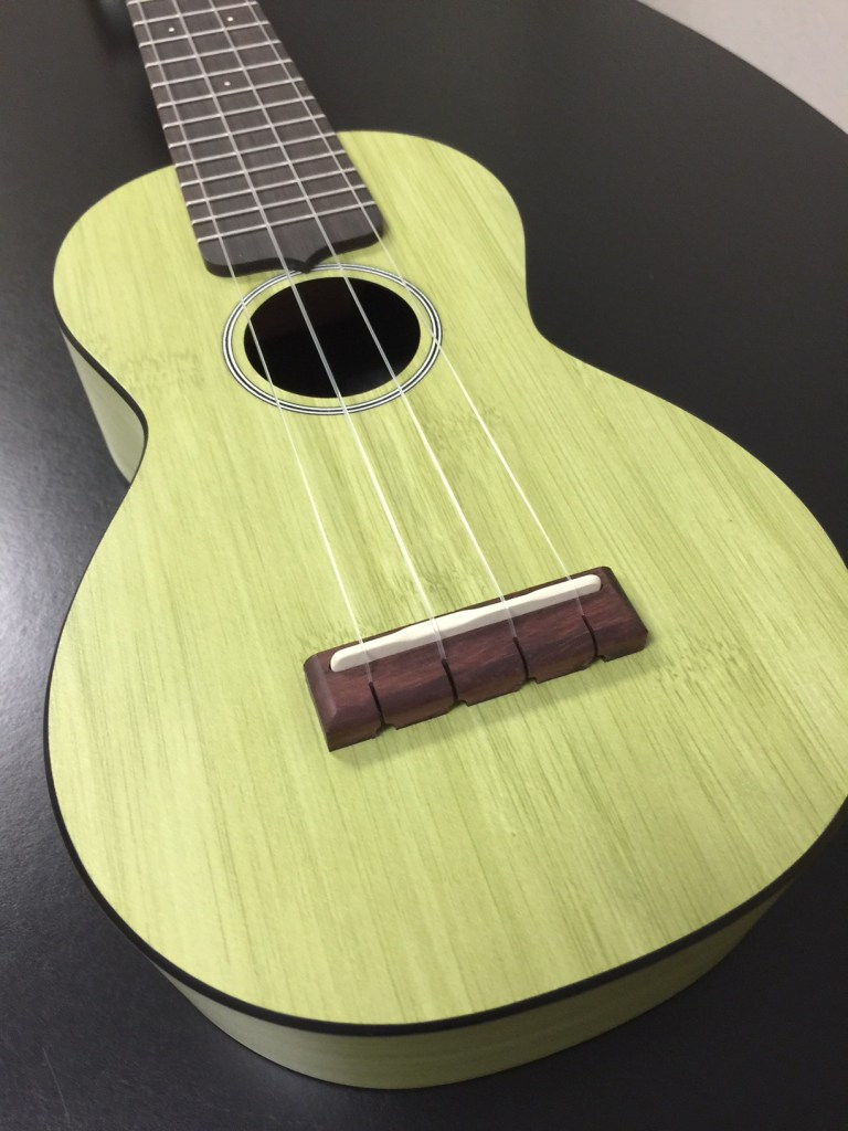 The body is made from Martin's HPL, a composite material, with Sitka spruce bracing and a bamboo-patterned finish on the top, back, sides, and headstock face.
