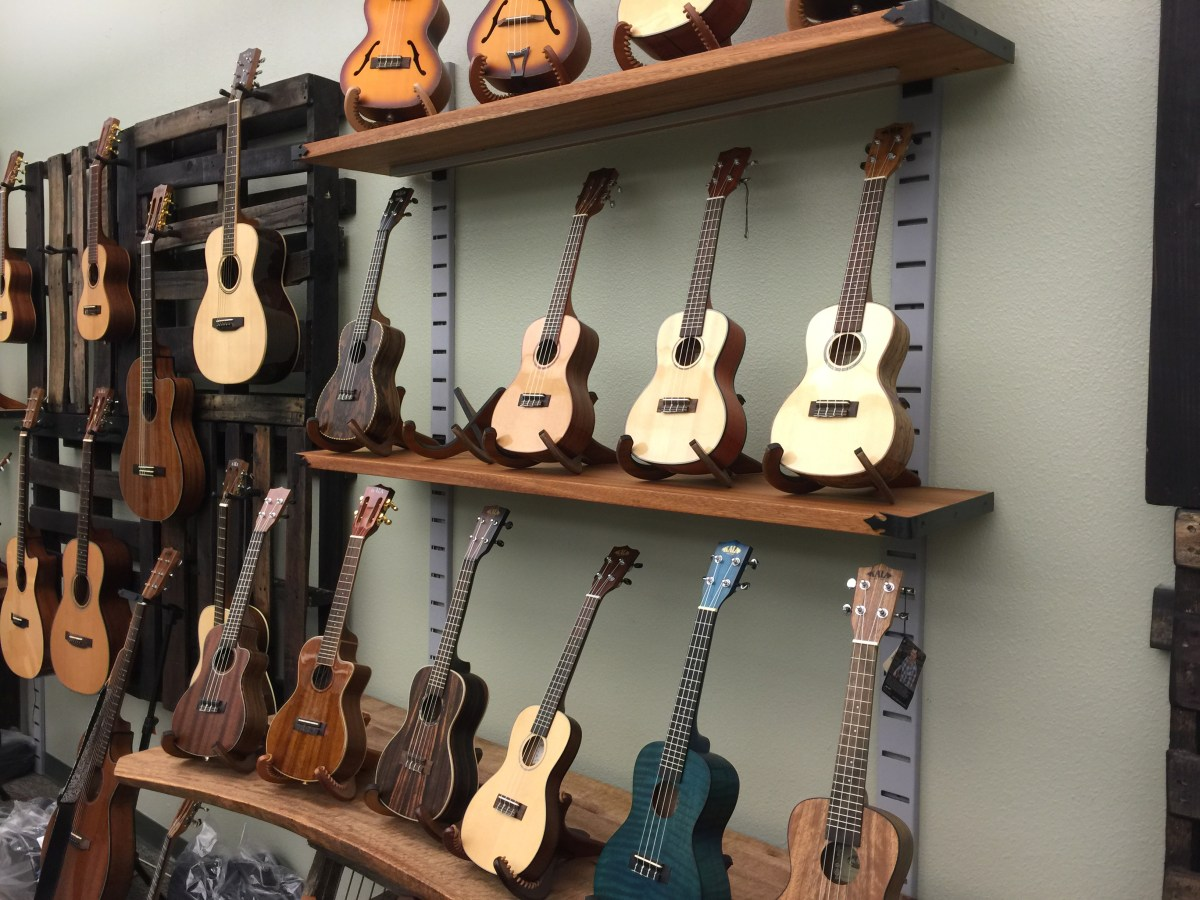 A portion of Kala's showroom, displaying some of its extensive lineup of ukuleles.