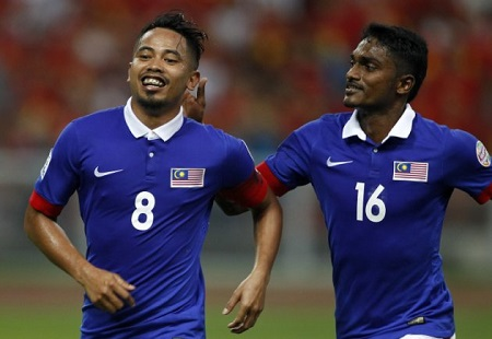 Malaysia's Safiq Rahim, left, and his teammate Kunanlan Subramanian celebrate a penalty goal against Vietnam during their semi final first leg soccer match of the AFF Suzuki Cup 2014 at a stadium in Shah Alam, outside Kuala Lumpur, Malaysia, Sunday, Dec. 7, 2014. (AP Photo/Lai Seng Sin)