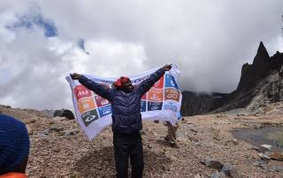 Photo: The Sustainable Development Goals flag waves on Mount Kenya.