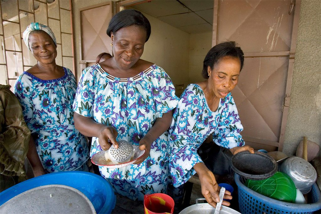 Photo: Ivorian widows run a small restaurant in Yopougon with the help of the non-governmental organization, Les Compagnes de Ruth. UN Photo/Ky Chung