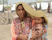 Photo: In Sindh province, Pakistan, a mother tries to shield her four-year-old daughter from scorching heat.