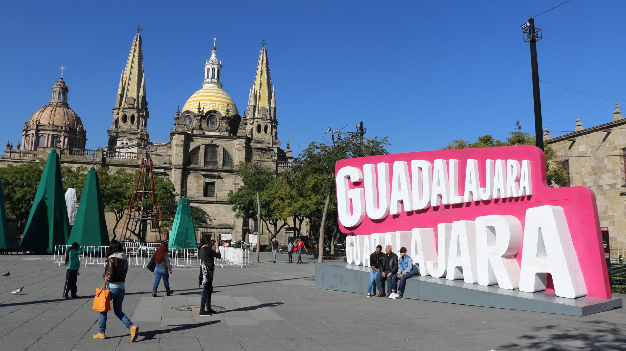 Photo: People walk on a plaza in Guadalajara''s central historic district.