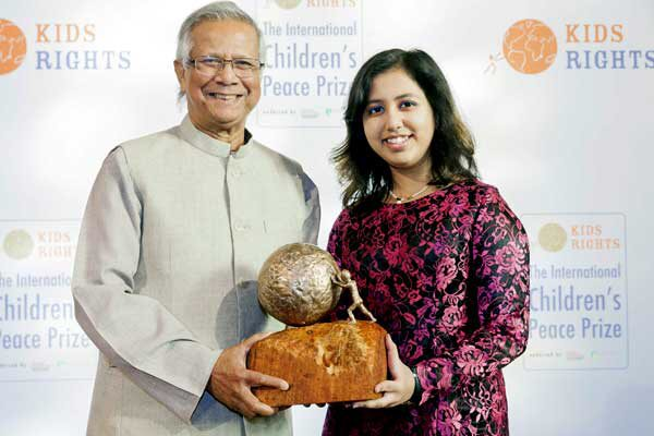 Muhammad Yunus with 2016 International Children's Peace Prize winner Kehkashan Basu Photo credit: Yunus Centre