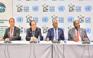 Photo: Under-Secretary-General Wu Hongbo (2nd from left) and South Africa President Jacob Zuma (2nd from right) address members of the media at the UN World Data Forum in Cape Town on 15 January.