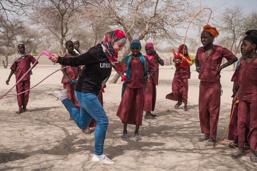 UNICEF Goodwill Ambassador Muzoon Almellehan skips rope with students at the School of Peace at a internally displaced peoples site in the Lake Region, Chad. She visited the conflict-affected region in April 2017. UNICEF/Sokhin