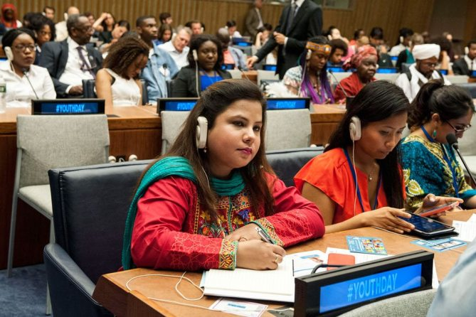"""Participants listen to speakers at the """"Youth Building Peace"""" event commemorating International Youth Day. UN Photo/Kim Haughton"""