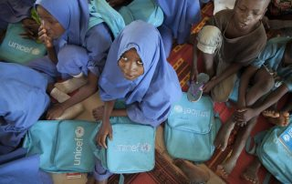 Children attend class in a UNICEF-sponsored school in Dikwa, Borno state, Nigeria. Boko Haram captured Dikwa in 2014 and the Nigerian army liberated it in February 2016. UNICEF/Naftalin (file)