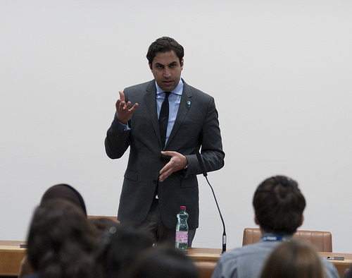 Ahmad Alhendawi speaking with UN interns and Junior Professional Officers (JPOs) at a Brown Bag Lunch