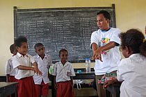 Betaf Elementary School students learn proper hand washing from Nelson Semriyanto Dudung, a university volunteer in Papua, Indonesia. (Alexandra Buftic, 2010)