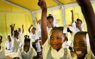 Young schoolgirls participate in class
