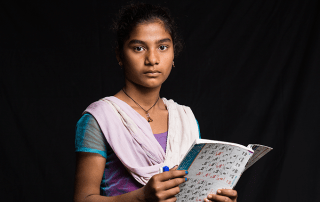 Photographer Vincent Tremeau traveled to communities in Nepal and Iraq where girls face a heightened risk of child marriage. He asked what they want to be when they grow up. Punita, 14, wants to be a teacher. © Vincent Tremeau