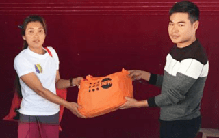 UNFPA field officer Kyaw Wai Aung delivers dignity kits to women who have fled the conflict zone © UNFPA Myanmar