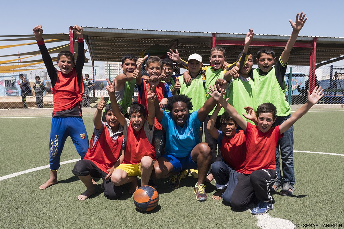 """""""Young people who survive war have an amazing ability to persevere and become champions of peace"""" Ishmael Beah (centre) in Zaatari April 2017"""