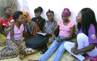 Mentor Edma Bartolomeu João discusses prevention of early pregnancy with adolescent girls in the 'safe space' created by Rapariga Biz in Namutequeliua, a neighbourhood of Nampula city in Mozambique. © UNFPA Mozambique / Helene Christensen
