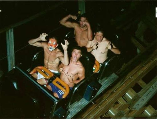 Topless guys on roller coaster