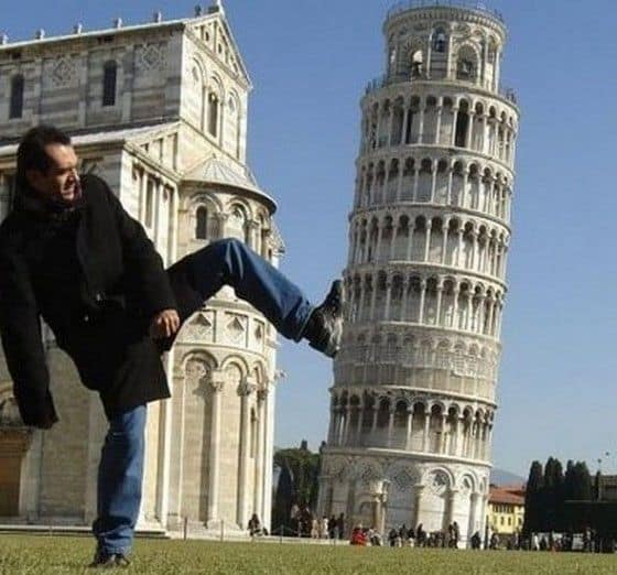 Man kicks over leaning tower of pisa
