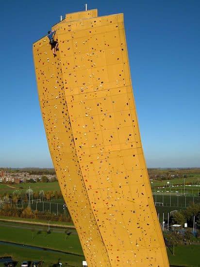 man reaches top of tallest climbing wall