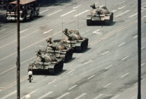 05 Jun 1989, Beijing, China --- A Beijing demonstrator blocks the path of a tank convoy along the Avenue of Eternal Peace near Tiananmen Square. For weeks, people have been protesting for freedom of speech and of press from the Chinese government. --- Image by © Bettmann/CORBIS
