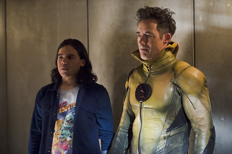 """The Flash -- """"Gorilla Warfare"""" -- Image FLA207B_0178b.jpg -- Pictured (L-R): Carlos Valdes as Cisco Ramon and Tom Cavanagh as Harrison Wells -- Photo: Cate Cameron/The CW -- © 2015 The CW Network, LLC. All rights reserved."""