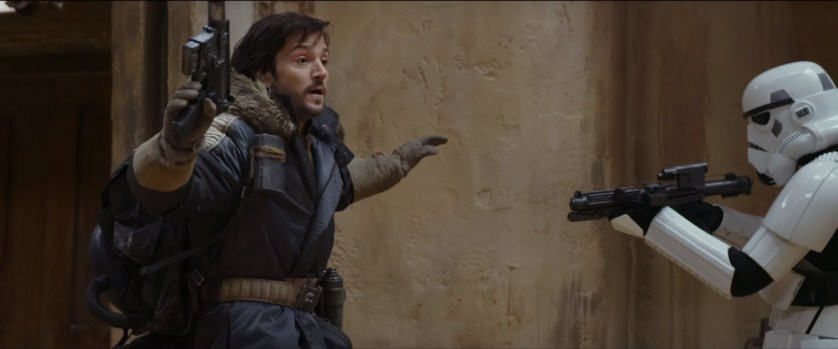 Cassian Andor (Diego Luna) held up by a Storm Trooper