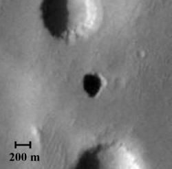 Possible cave entrance on Mars. Image credit: NASA/JPL