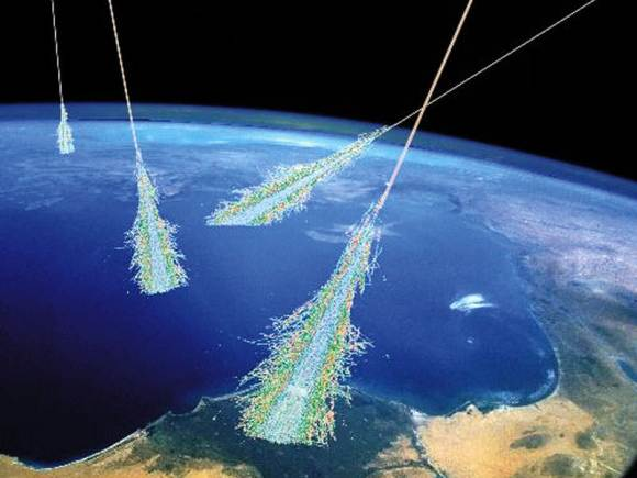 Showers of high energy particles occur when energetic cosmic rays strike the top of the Earth's atmosphere. Cosmic rays were discovered unexpectedly in 1912. Illustration Credit: Simon Swordy (U. Chicago), NASA.
