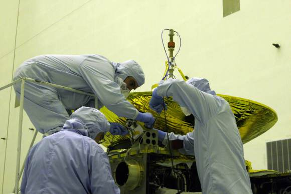 Engineers working on the New Horizons spacecraft's Pluto Energetic Particle Spectrometer Science Investigation (PEPSSI) instrument. Credit: NASA