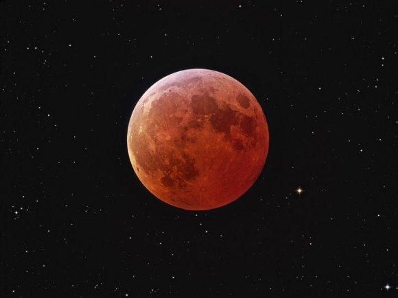 Composite picture of  a dark red Moon during a total lunar eclipse. Credit: NASA/ Johannes Schedler (Panther Observatory)